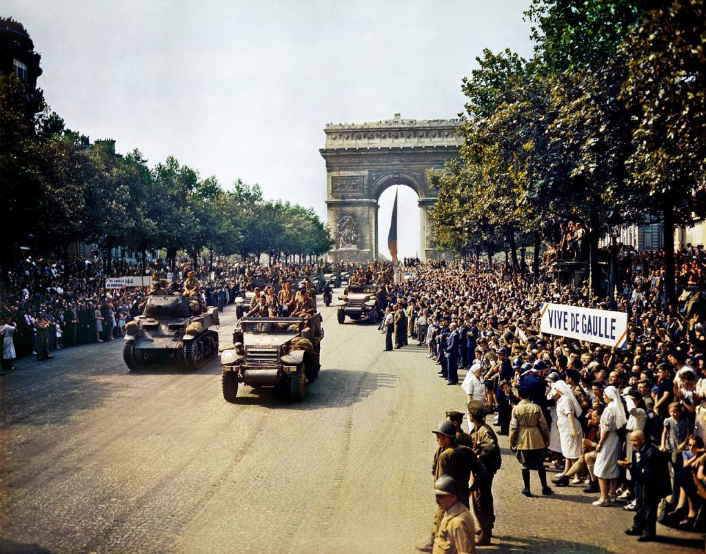 Crowds greet the liberators of Paris on the Champs Elysee