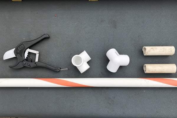Jump bar, 2 PVC 3-way elbows, cut cavaletti feet, and a PVC cutter