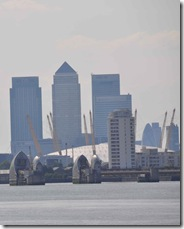 Thames Barrier, in front of the O2 dome and Canary Wharf
