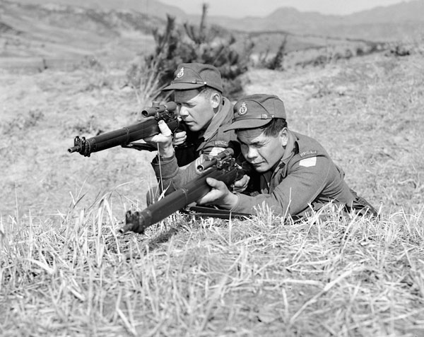 Black-and-white photo of two Canadian snipers aiming at an unknown target..