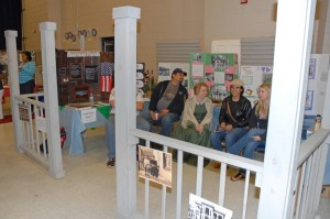 VGCC History instructor Victoria Klesmith (center, in period attire) and students created a booth on the American front porch for the 2013 Cultural Fair. (VGCC photo)