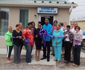 Shown at the Henderson-Vance Chamber of Commerce ribbon cutting for Stepping Out Hair Studios, LLC are, Front row, left to right; Valeda Glover, Stepping Out Hair Studios; City Councilwoman Brenda Peace-Jenkins; Wytisha Nicole Green, owner Stepping Out Hair Studios, LLC; Dwayne Green, husband; Deborah Brown, County Board of Commissioners Chair; Melody Hargrove, Stepping Out Hair Studios, LLC; Jenny Hester, Prim Development and HVCC Board Chair; back row left to right; Chamber Ambassador Clareese Moss, New You with Shortcakes; Chamber Ambassador Julia Langston, Henderson Family YMCA; Bianca Peace; Connie Ragland, HVCC Work First Coordinator; Chamber Ambassador Val Short, Triangle North Healthcare Foundation; Chamber Ambassador Pam Norwood; John Barnes, HVCC President; Not pictured: Melanie Mann, HVCC Office Manager; Annette Roberson, HVCC Director of Membership Services.
