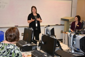 Marianne Durling of Granville Health System speaks to VGCC students, as instructor Hollie Garrett (seated at right) listens. (VGCC photo)