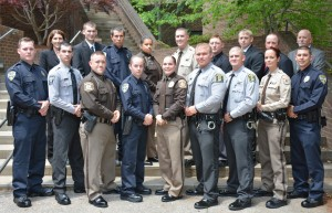 On front row, from left, VGCC Basic Law Enforcement Training Class 100 graduates Jason Lee Grainger, Bronson Douglas Murphy, Matthew Scott Craft, Brittany Lauren Strother, Katherine Leigh Keville, Ryan Hulett Woodlief, Joshua Adam Bailey, Leigh Hester and Daniel Scott Watson; on back row, from left, VGCC law enforcement training coordinator Andrea Ferguson, graduates Kenneth William Fitzsimmons, Jr., Zeb Landon Robinson, Melinda Ann Hester, Tyler Brady Currin, Matthew Ryan Groves, Joshua Wayne Garrett, Mark Anthony Williamson and VGCC instructor Glen Boyd. (VGCC Photo)