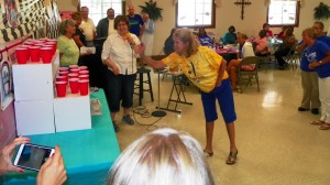 Assistant Principal Ann Hancock attempts a ping pong ball toss.