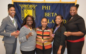 Phi Beta Lambda chapter officers for 2015-16 include, from left, president Angelica Bridges of Oxford, vice president Ambrianna Winston of Oxford, secretary Ashley Allen of Henderson, historian Shekinah Yancey of Oxford and treasurer Tiffany Barnes of Henderson. Each holds a candle symbolizing her leadership role. (VGCC photo)
