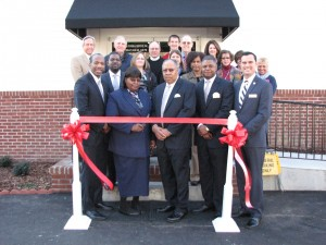 Shown at the Henderson-Vance Chamber of Commerce ribbon cutting for Davis-Royster Funeral Service are, Company owners Mary & James Royster; Davis-Royster Funeral Service, manager Paul Crews Jr.; Davis-Royster Funeral Service, apprentice Rumeal Fergusion; Davis-Royster Funeral Service, mortician Robert Wright III; Mayor Eddie Ellington; Henderson-Vance Chamber of Commerce, president John Barnes; HVCC, workfirst coordinator Vanessa Jones; HVCC, board member chair Larry Mathiot, CentryLink; Stephanie Ranes and Diane Robbins of the Daily Dispatch; HVCC, board member Jon Anderson, BB&T;  Vance Construction Company, president Robert Kemp, Jr.; HVCC, ambassador Clareese Moss, Shortcakes; HVCC, ambassador Tonya Moore, KARTS; Benchmark Community Bank, Ann Lawson; PRIM Development & Rentals, Jenny Hester.  Not Pictured: HVCC, director of membership services, Annette Roberson; HVCC, director of communications Sheri Jones.