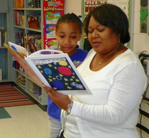 Principal Crystal Richardson reads one of the stories in the book.