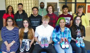 SVHS art students include, front row from left, Sandy Hernandez, Ashley Mosley, Cameron Hux, Aliyah Wright and Krista Pendergrass. On the back row are, from left, Assistant Principal Mcshell Edmonds, Jose Reyes, Jose Gonzalez, Tony Elberson, Jordan Salazar and Principal Stephanie Ayscue. Standing at back center is Assistant Principal Desmond Thompson.