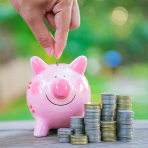HSA Contributions - Approaching the Tax Deadline (image of a hand putting coins into a piggy bank)