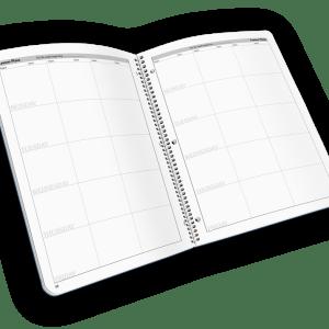 Open spread spiral-bound grade book with weekdays.