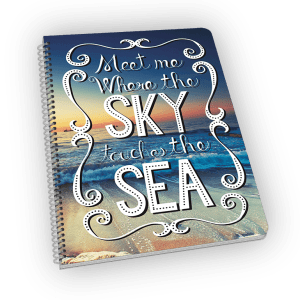 Spiral-bound notebook with ocean and sky cover.