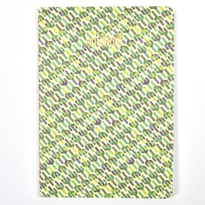Small composition notebook with cacti pattern.