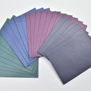 Set of colored card envelopes fanned out.