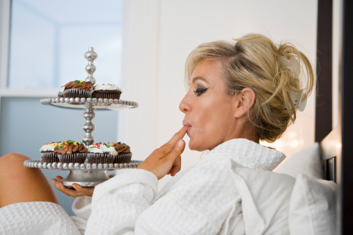 Woman Enjoying Sweets 124814500