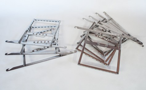 Eight stainless steel 4x5 film developing hangers.