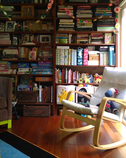My daughters' room is cozy with an ever increasing library of books, games and toys.