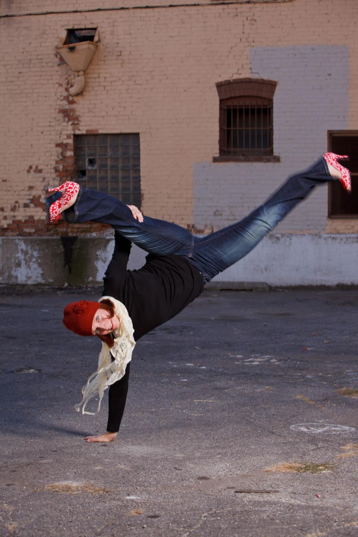 Anne demonstrates capoeira, the Brazillian martial art