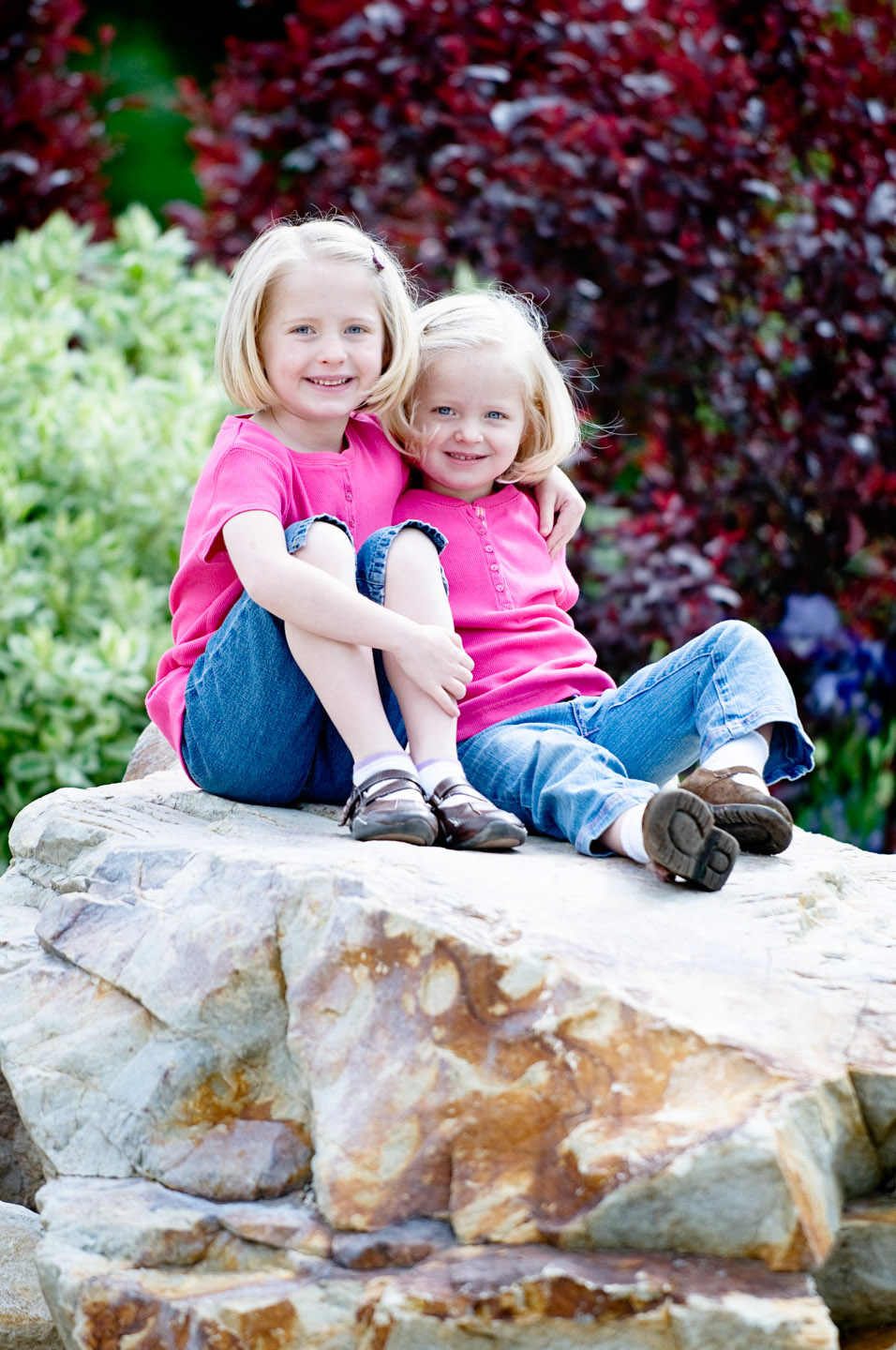 Maren and Julianne hang out on a rock