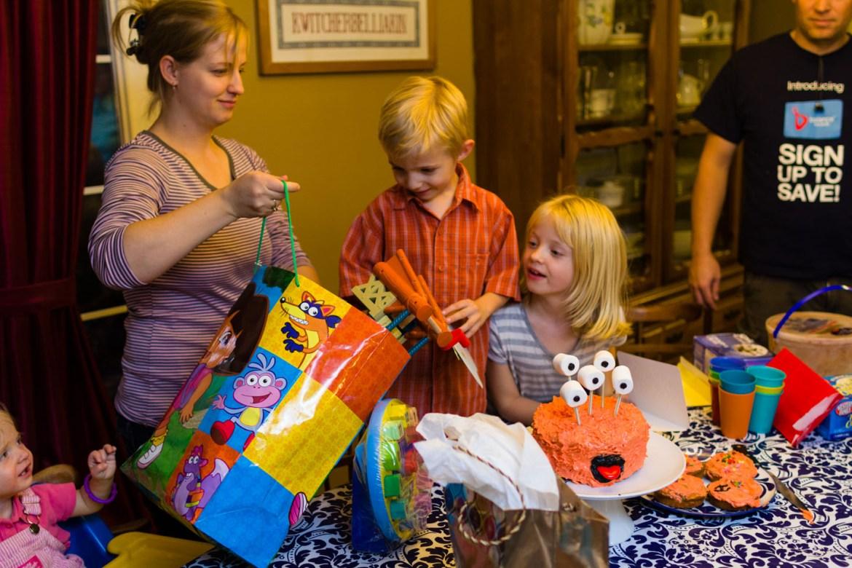 Henry unwraps his birthday presents