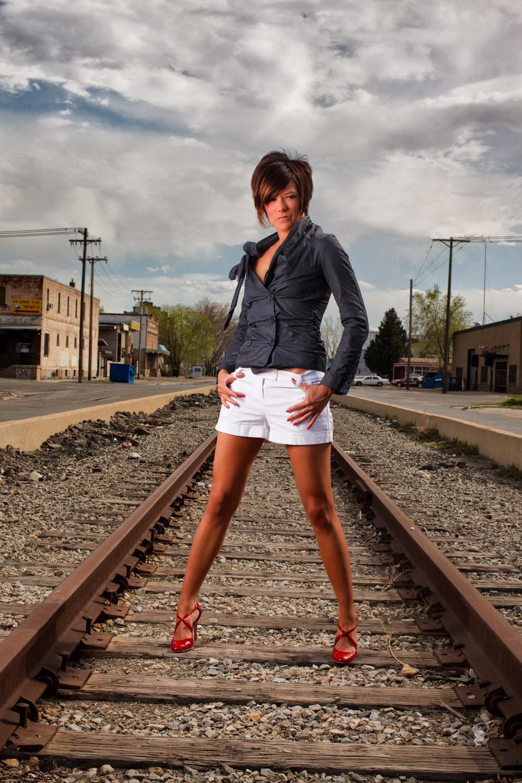 Kristen models on abandoned train tracks