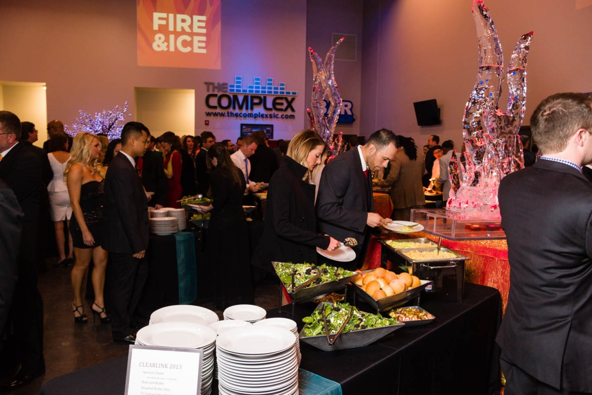 People enjoy the buffet catered by Le Croissant Catering