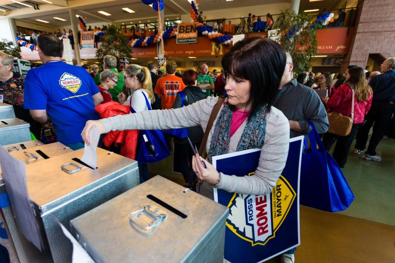 A delegate casts her ballot
