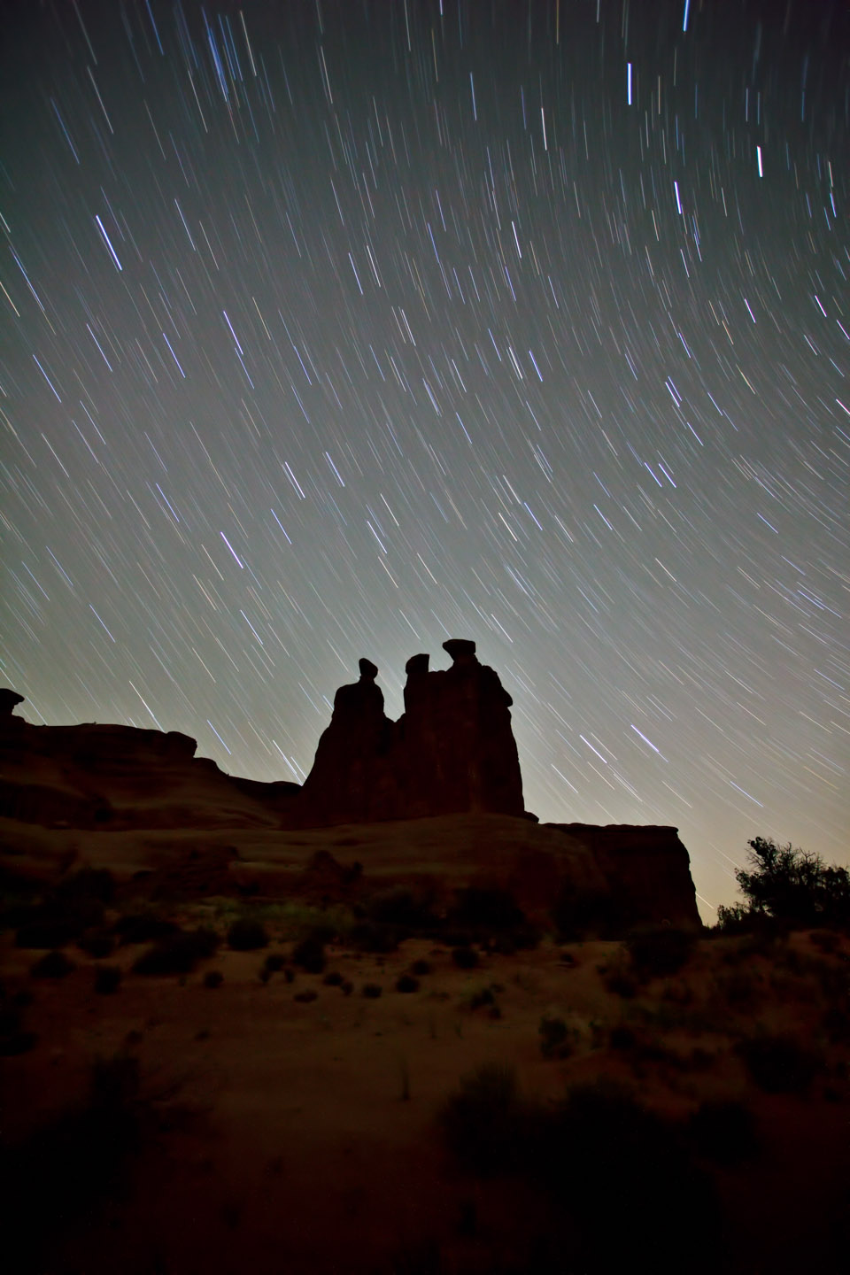 Star Trails at night over Moab Three Gossips