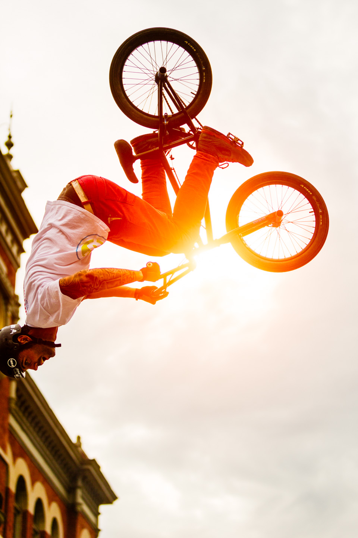 BMX Cyclist performs a backflip