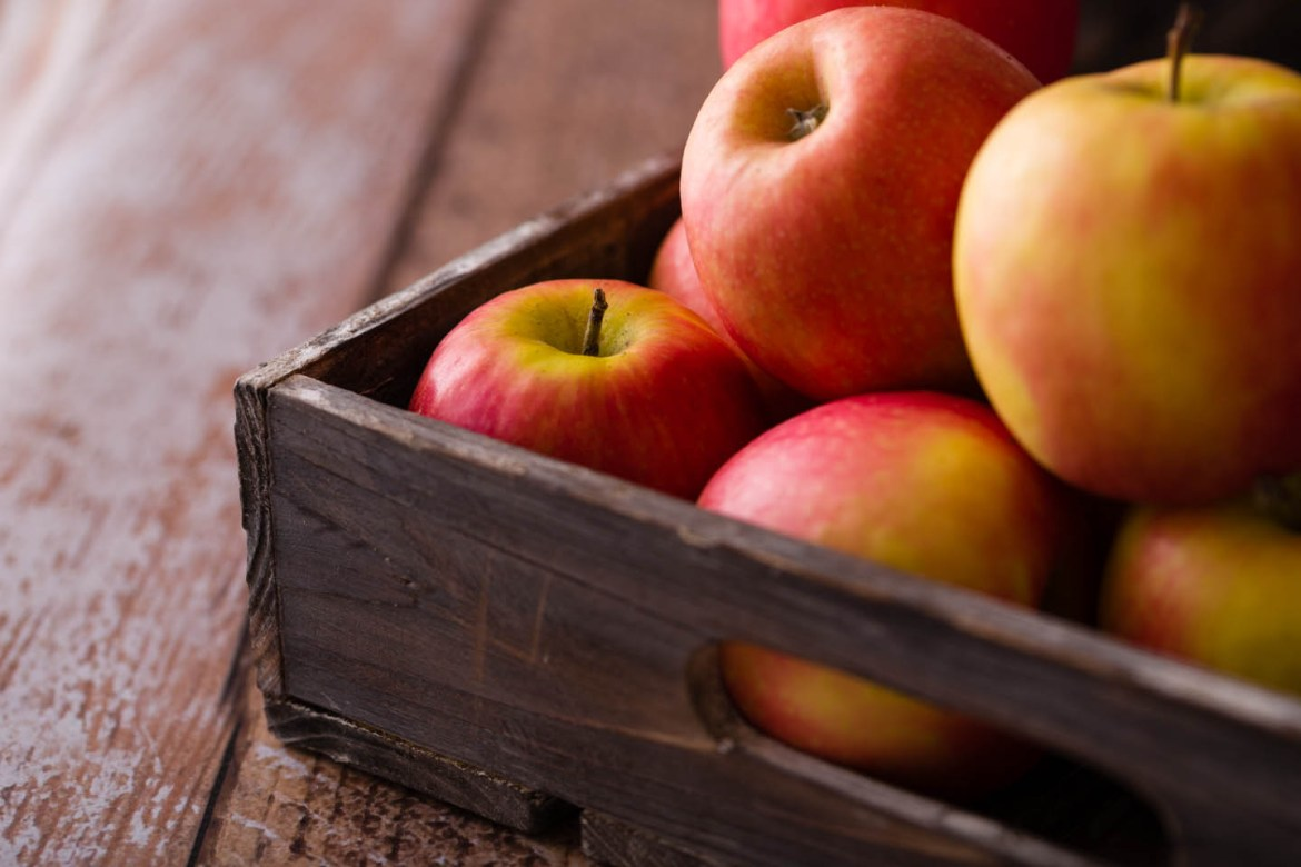 Apples in a crate on yet another vinyl prop