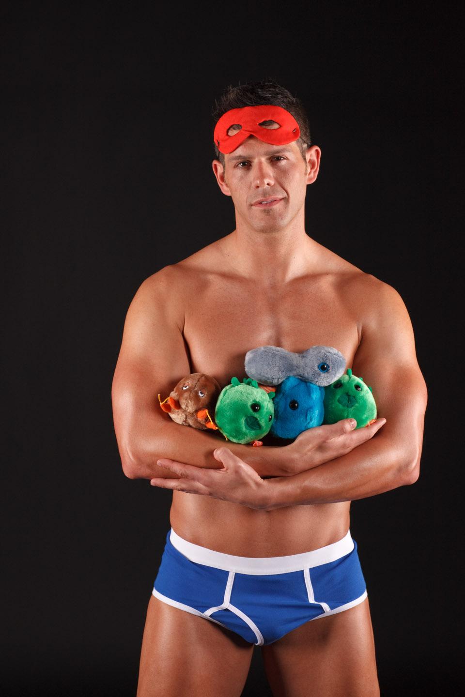 Eric Holds Stuffed Animals that represent STDs