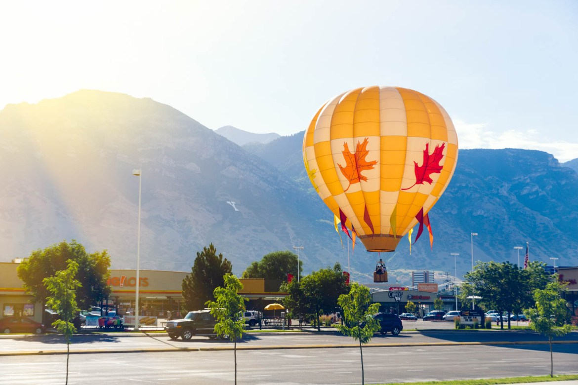 A hot air balloons prepares to land in the Big Lots parking lot