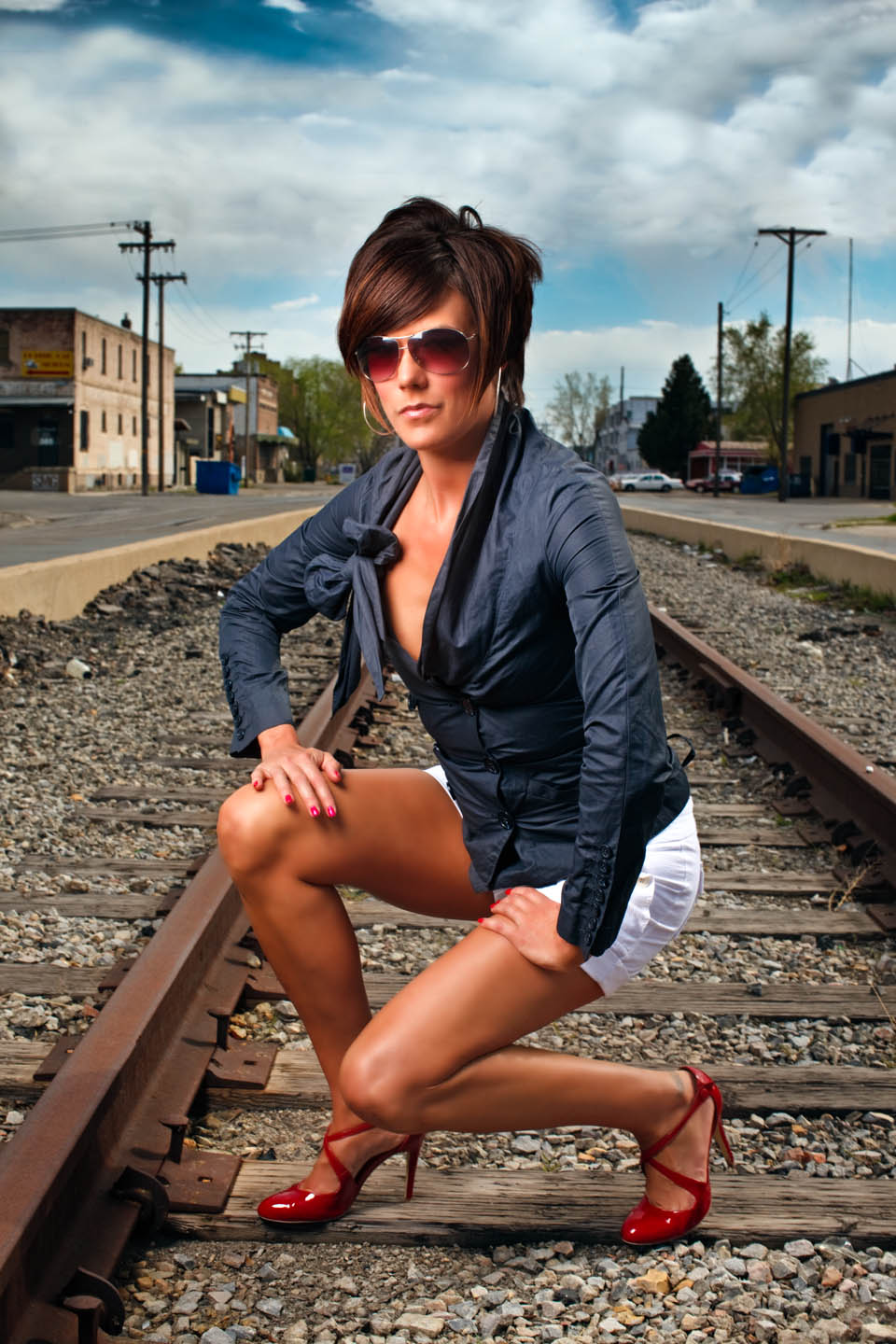Kristin on train tracks. It's safe these tracks are abandoned.