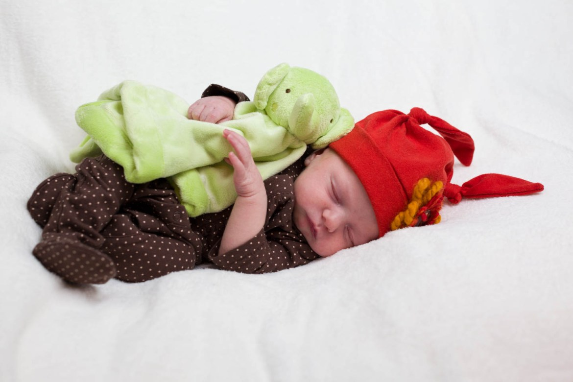 Baby Britain sleeps with her green elephant snuggle blanket