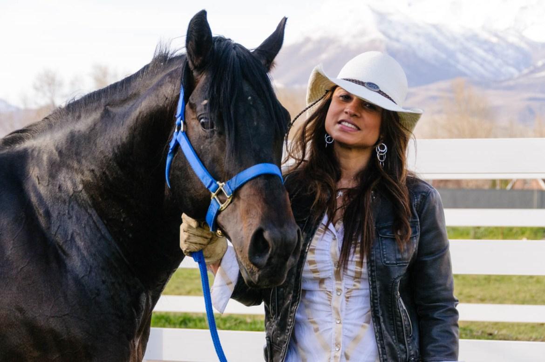 Black arabian stallion and his owner