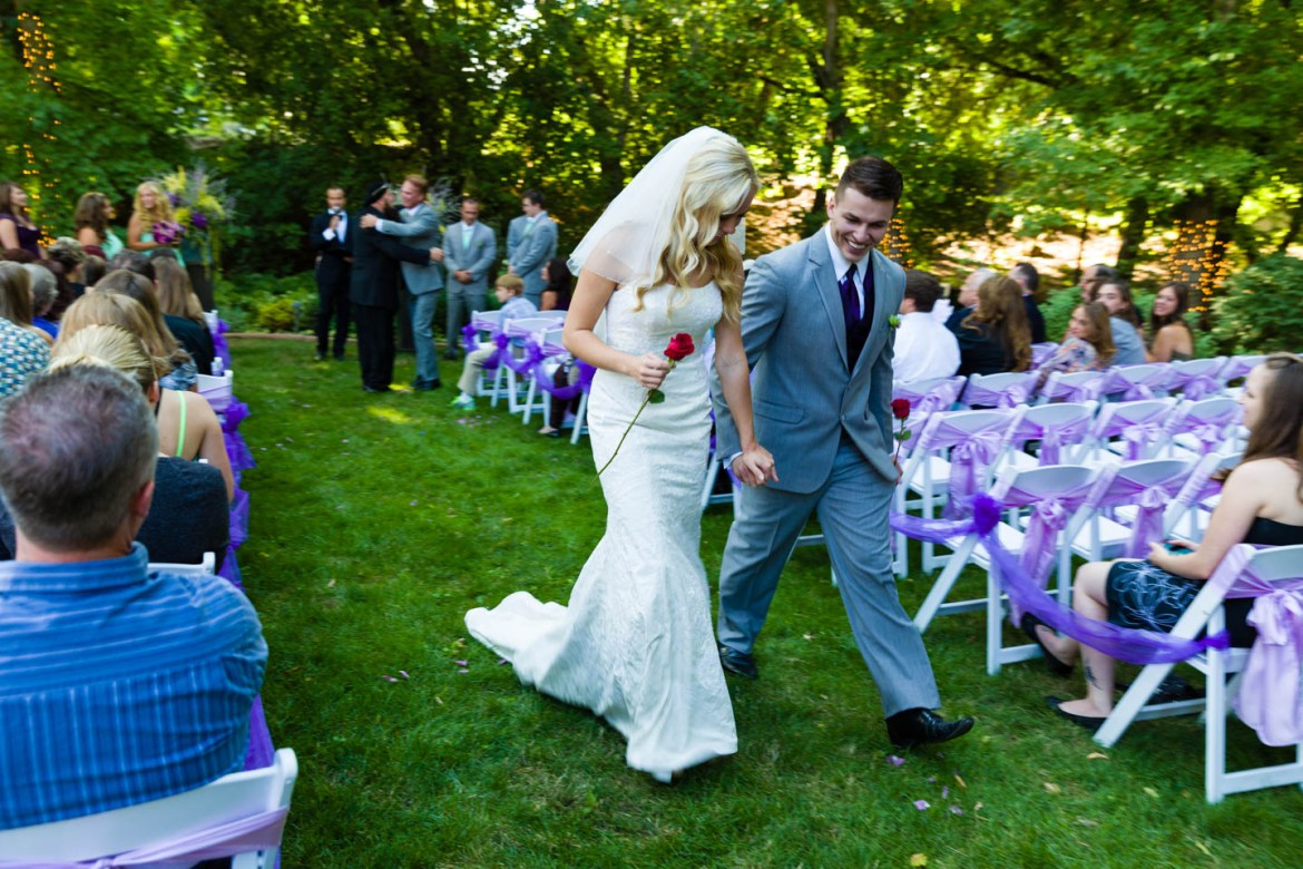 Bride and groom walk up the aisle after the ceremony