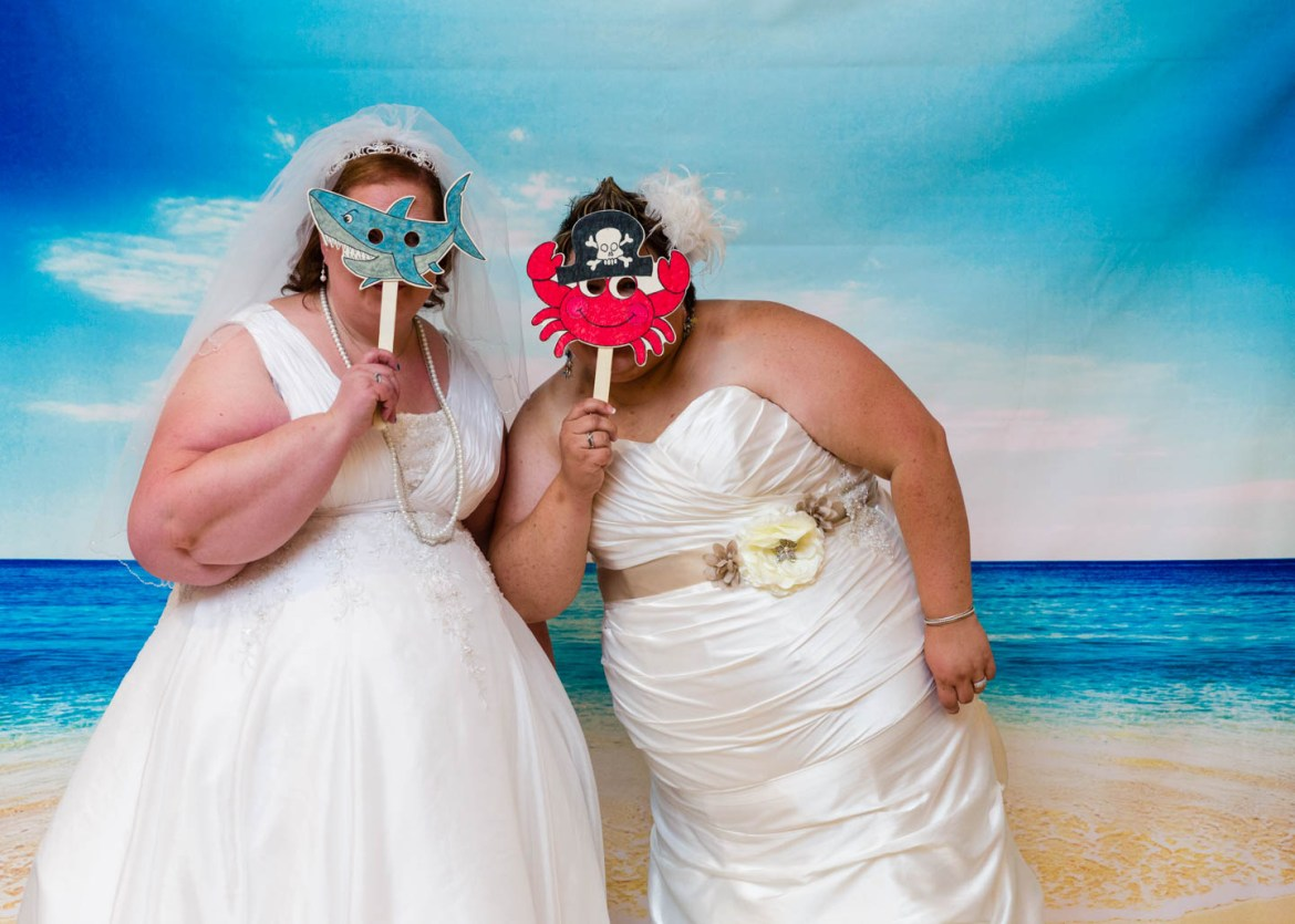 Brides in the beach themed photo booth