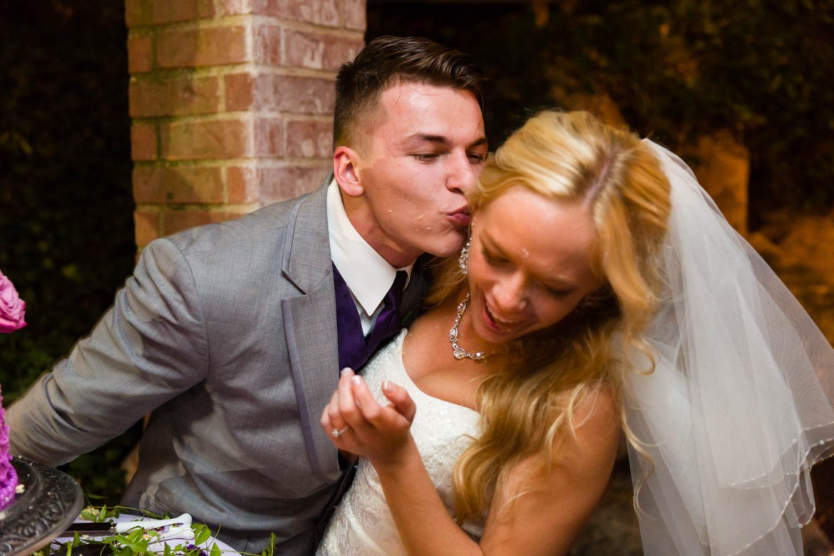 Groom kisses the bride after the cake cutting