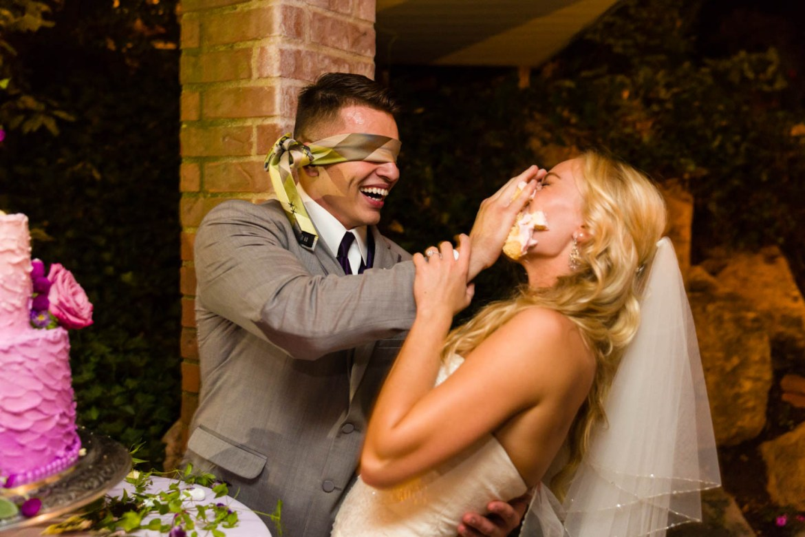 Groom smashes the wedding cake on the bride's face