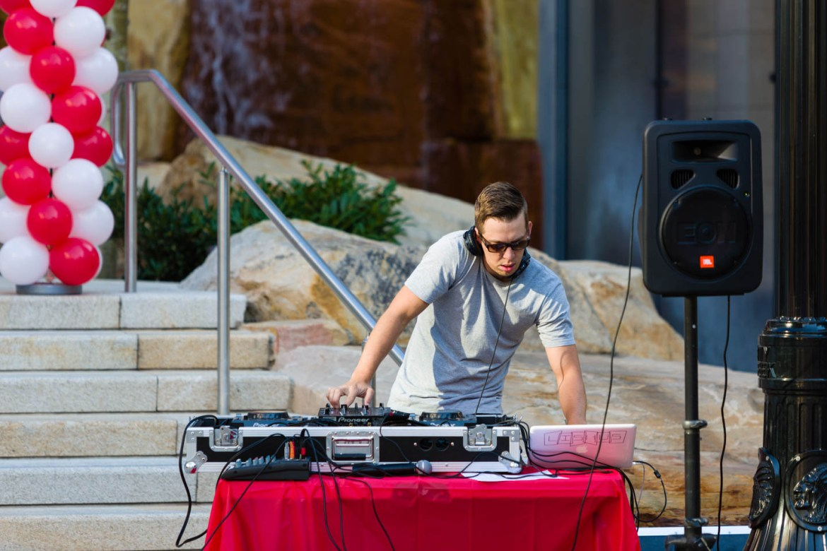 DJ Lishus spins the music as people gather at City Creek for the Walk