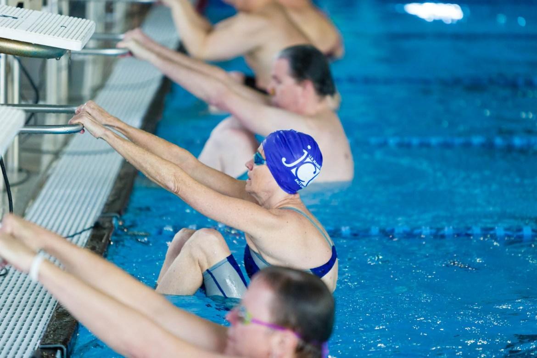 Swimmers start for the backstroke relay