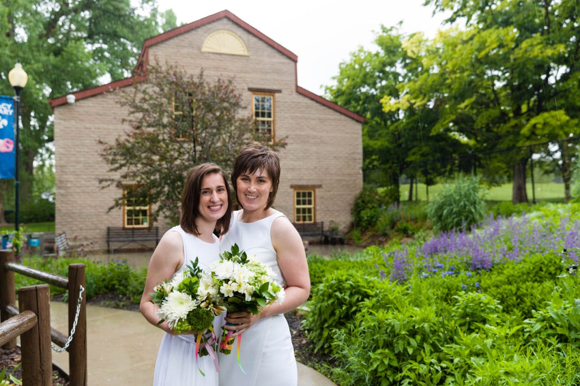 Formal wedding portraits in front of the Chase Mill at Tracy Aviary
