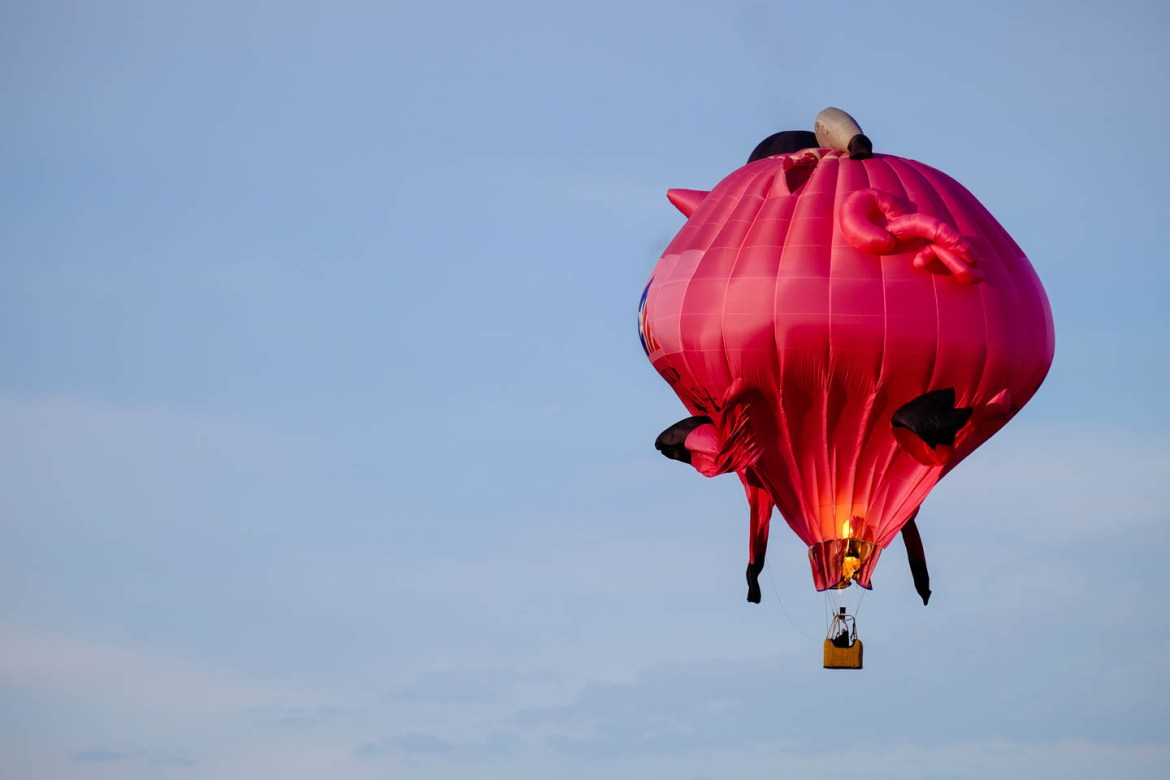Amazing photo of the pink pig balloon crashing. You see the hole and the fire