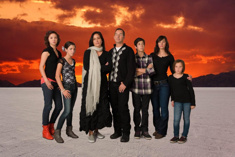 Family on the Salt Flats with a dramatic sky