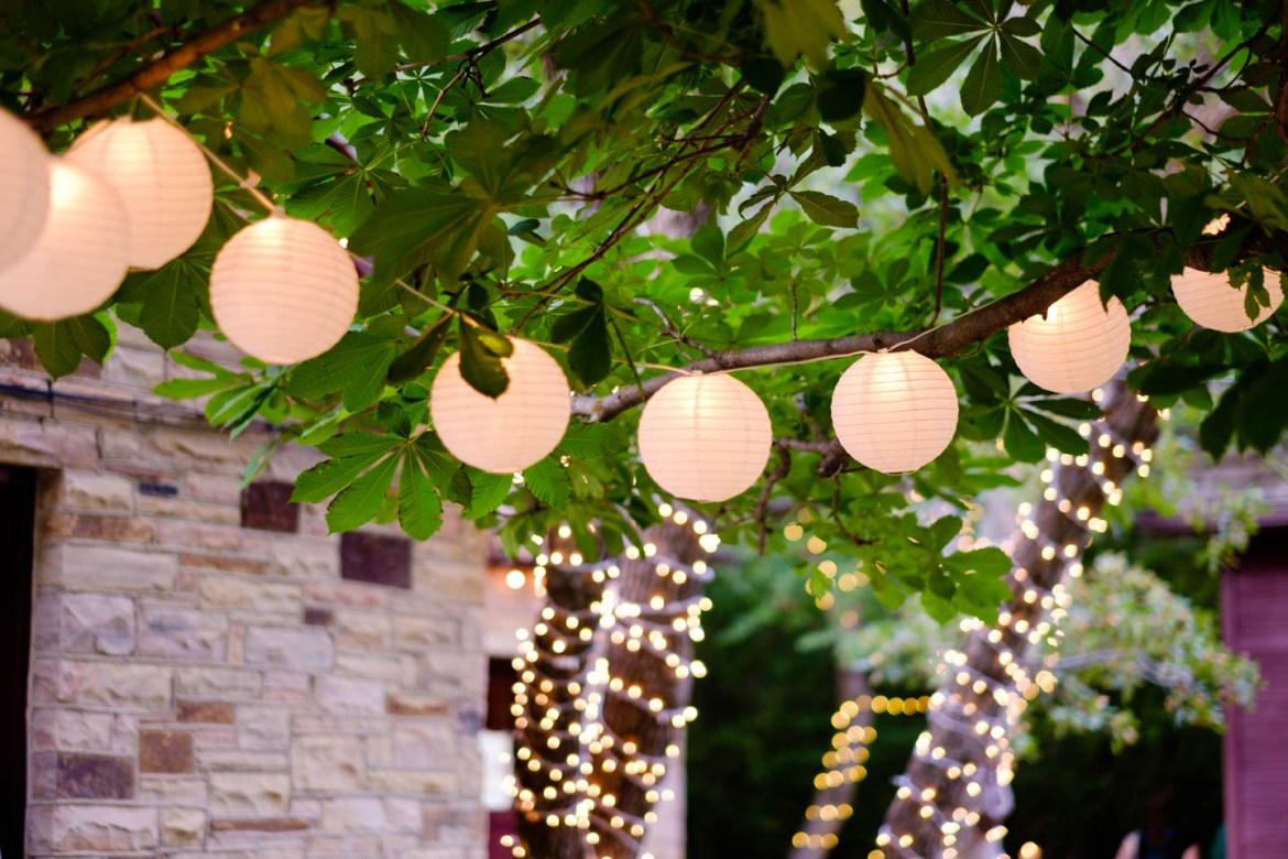 Chinese lanterns and christmas lights decorate the trees