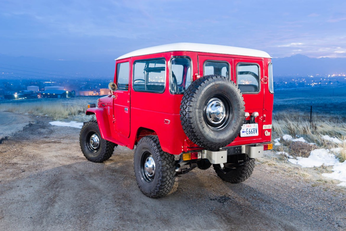 Red Toyota Land Cruiser photographed early in the morning