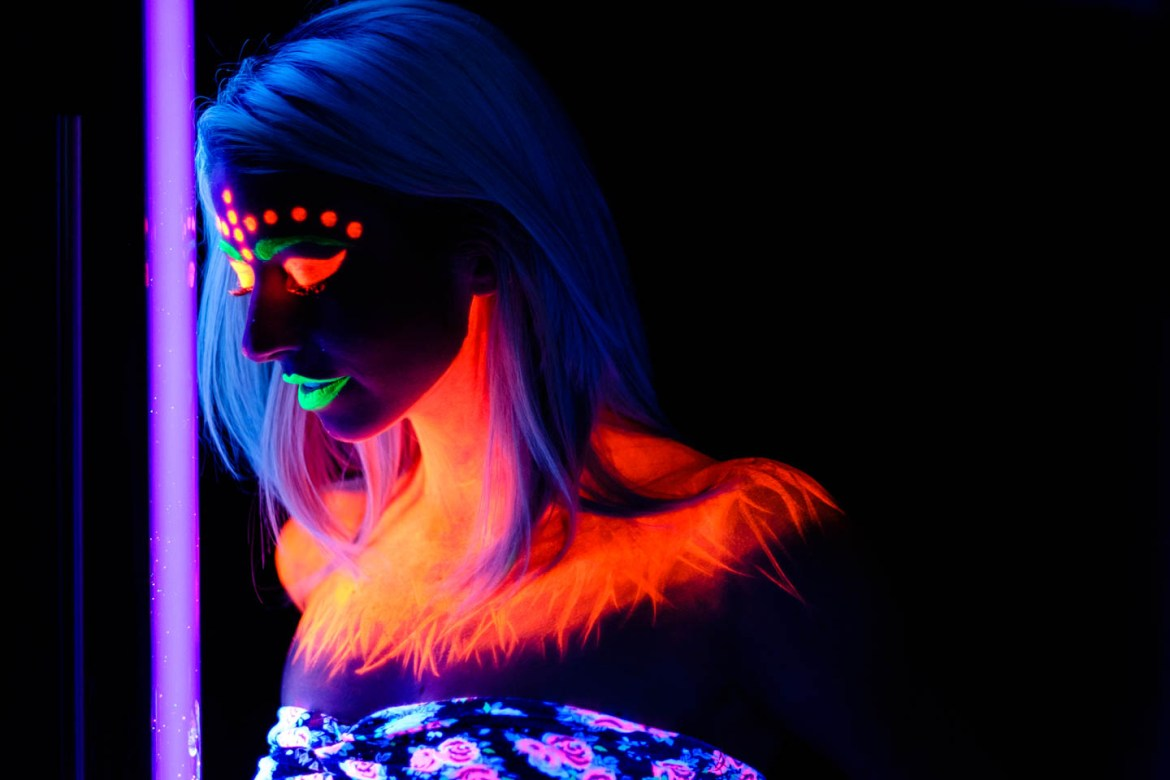 A model painted with blacklight paint and lit by blacklight