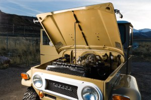 Wide view of the Toyota Land Cruiser with hood open