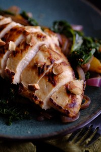 A chicken dish with almonds, apples, and red onions