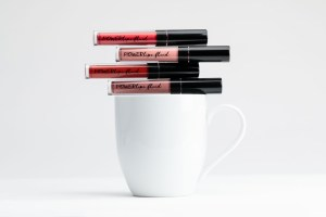 POWERLips Fluid on a Coffee Cup